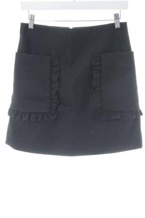 COS Jupe en laine noir style décontracté