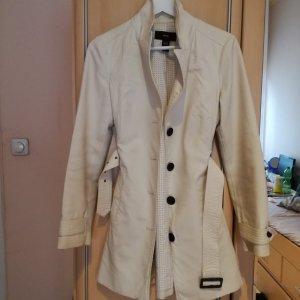 Creme farbener Trenchcoat