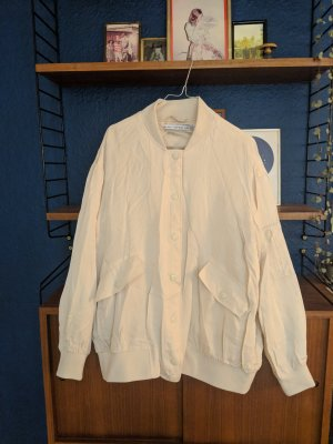 Creme silk look bomberjacket