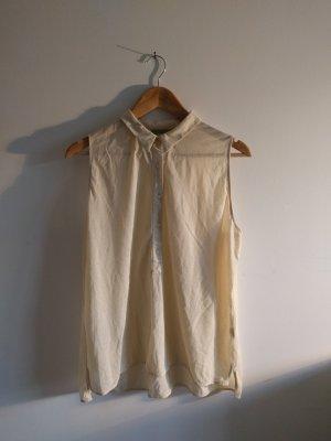 Cremefarbene, ärmellose COS Bluse