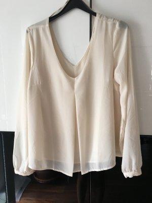 Cremefarbene Bluse mit V- Ausschnitten vorne und hinten