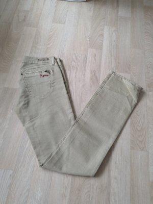 Cremefarbene neue Jeans