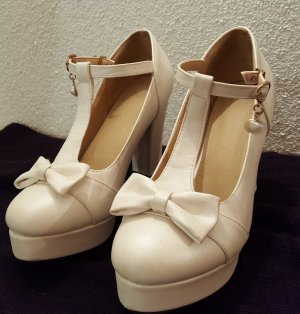 Strapped pumps natural white