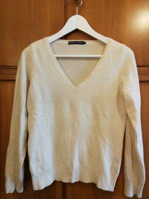 cremefarbener Pullover mit V-Ausschnitt