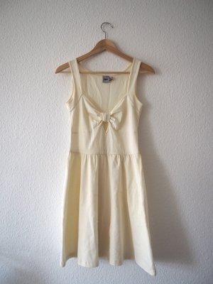Cremeweißes Sommerkleid mit Schleifenoptik, S