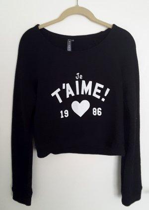 Cropped Pullover in schwarz mit weißem Print
