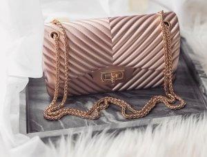 Bolso de mano color oro-rosa