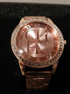 Reloj analógico color rosa dorado