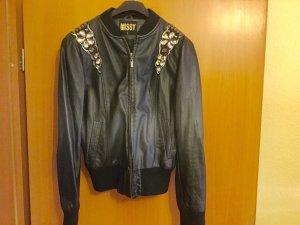 100 Blusón negro Imitación de cuero