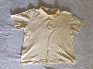 Camiseta tipo polo amarillo claro