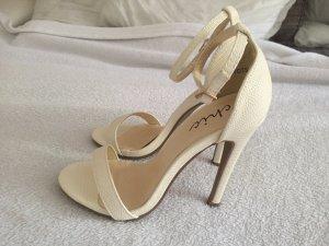 High-Heeled Sandals white