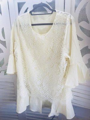 Blusa in merletto giallo chiaro