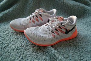 Nike Sneaker stringata bianco-arancio neon