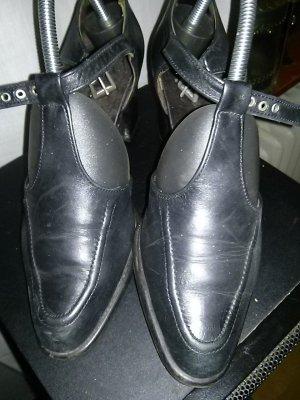 Zapatos de tacón con barra en T negro Cuero