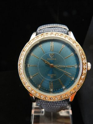 Reloj con pulsera de cuero color oro-petróleo acero inoxidable