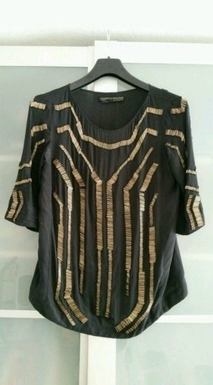All Saints Blusa de seda negro-color oro