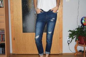 Destroyed Blue Jeans