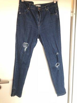 Destroyed Skinny Jeans mit Reisverschluss