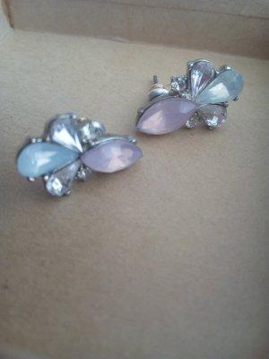 Boucle d'oreille incrustée de pierres mauve-bleu azur