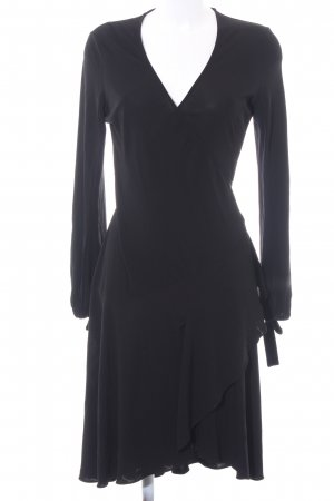 Diane von Furstenberg Vestido cruzado negro look casual