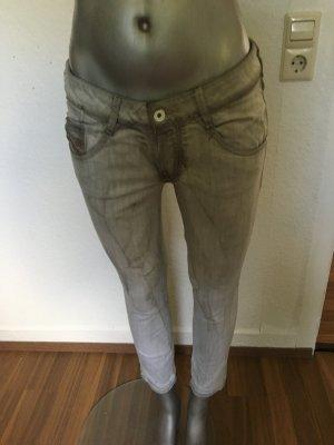 Diesel Jeans hellgrau mit seitlichen Reißverschlüssen am Bein Gr. 27/30