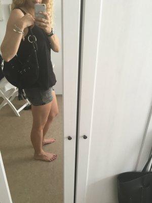 DKNY Tasche mit lederdetails und silbernen Applikationen