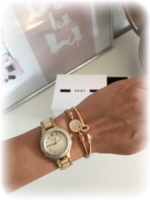 DKNY Montre avec bracelet métallique doré