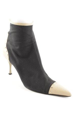 Dolce & Gabbana Reißverschluss-Stiefeletten schwarz-creme Street-Fashion-Look