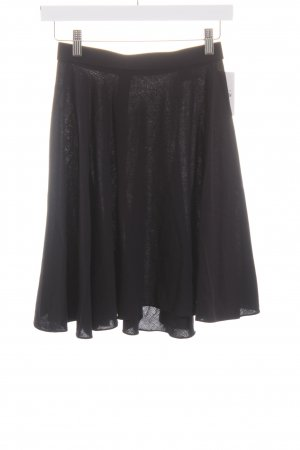 Donna Karan Falda asimétrica azul oscuro look casual