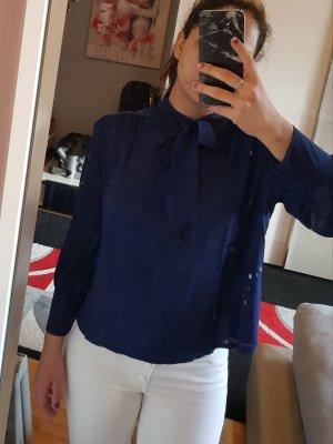 Blusa con lazo azul oscuro
