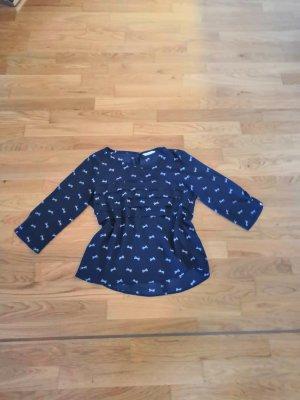 Dunkelblaue Bluse mit weißen Schleifen