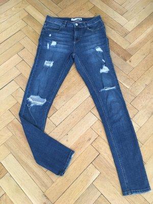 Dunkelblaue destroyed Skinny Jeans von Topshop, Moto, Größe 26/34
