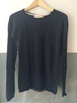 Dunkelblauer Pullover mit weißen Muster