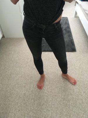 Dunkelgraue Ankle-Jeans Low-Waist Gr. 25/30 mit Reißverschluss am Knöchel