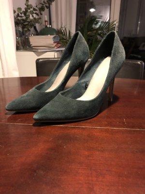 Dunkelgrüne High Heels