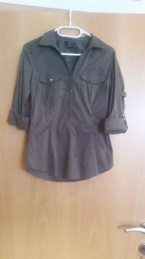 Dunkelgrüne lange Bluse