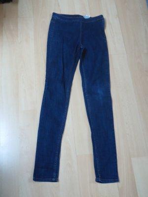 dunkle Jeans mit Reißverschluss an der Seite