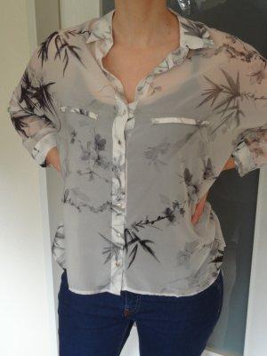 Durchsichtige weit geschnittene Bluse mit Blumenmuster Gr. S