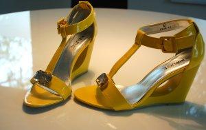 Sandalo con tacco alto e lacci a T giallo-giallo pallido Finta pelle