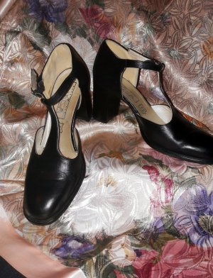Zapatos de tacón con barra en T negro-crema Cuero