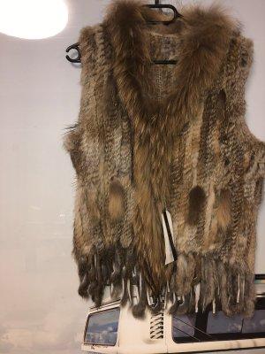 Chaqueta de piel marrón grisáceo