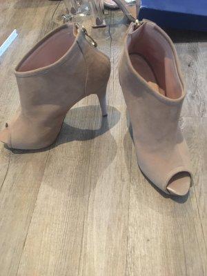 Laarzen met hak beige