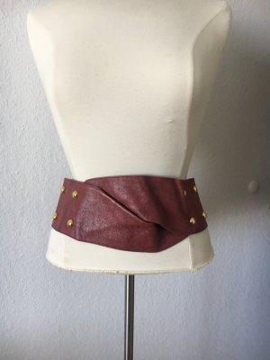 Cinturón pélvico carmín