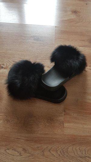 Mules black pelt