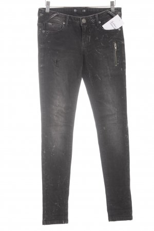 Ecko Röhrenjeans schwarz-grau Farbtupfermuster Street-Fashion-Look
