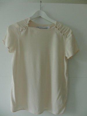 Ecru-farbene Bluse mit Knöpfen an den Ärmeln