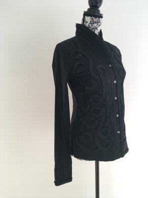 Edle schwarze Bluse mit Applikationen und hohem Kragen