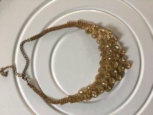 Collier incrusté de pierres doré