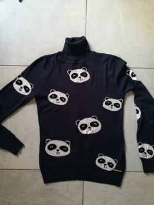 ein süßes Pullover mit Waschbären