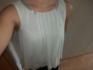 Eine Bluse ohne Arm in Silber/grau